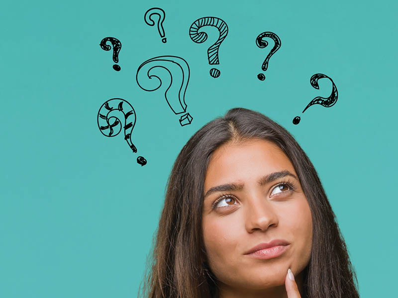 Person with question marks above head